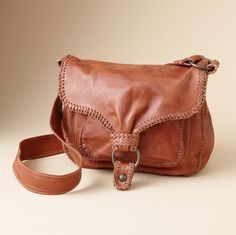 FRYE MADDY MESSENGER BAG--Frye® uses hand whipstitching on its sumptuous weathered leather bag to accentuate its rugged, slightly rustic appeal. One pocket beneath the magnetic snap closure
