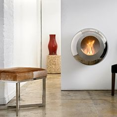 Vellum Stainless Steel Fireplace by Cocoon Fires - a little mod for me, but still pretty cool!