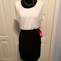 NWT Gorgeous Layered Skirt Dress 1 piece Skirt is layered & super cute! One piece dress has the appearance of two pieces. Pullover dress, no buttons or zips. Size M (guessing a juniors medium). NWT Sweet Storm Dresses