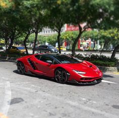 Lamborghini Centenario Coupe painted in Rosso Efesto w/ exposed carbon fiber   Photo taken by: @wmootw on Instagram