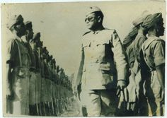 Prominent Indian nationalist, Subhash Chandra Bose reviewing troops  of the Azad Hind Fauj, an Indian military unit raised in 1941 in Germany, attached to the German Army and later from August 1944 attached to the Waffen-SS. The initial recruits were Indian student volunteers resident in Germany at the time, and a handful from the Indian prisoners of war (POWs) captured by Rommel during his North Africa Campaign. It would later draw a larger number of Indian POWs as volunteers.