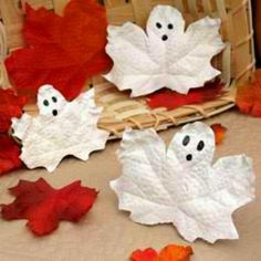 Paint fake leaves white and give it a ghostly face! Cute!