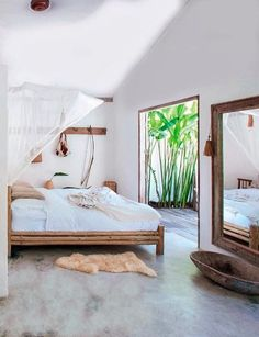 We love this bright and airy bedroom. Plenty of natural light and a large door add to the summery feel.