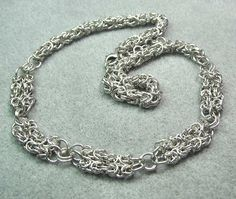 It's a version of Byzantine weave, done up in sterling silver -- which I think is yummy!