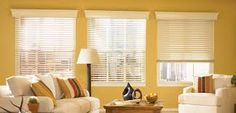 White Wooden Blinds with White Wooden Cornices keep the room light and open but also keeps the light and heat out.