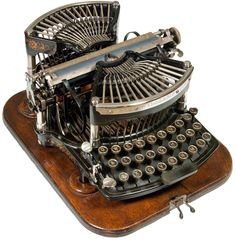 This guy's collection is incredible - amazing how many of these antique typewriters could be read as modern steampunk... Williams 1 - curved keyboard