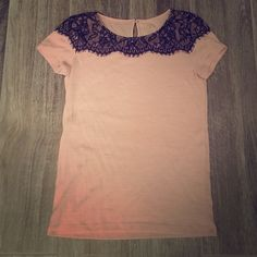 Ann Taylor Loft pink and black top Ann Taylor Loft pink with black lace design. Size XS petites. Took a pic of the slight balling on the midsection of the top. Ann Taylor Tops