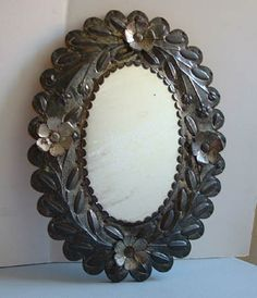 Mexican Handcraft  1930's Antique Tin Mirror -  Hand-made tin mirror shows fine workmanship and detail on the oval frame. The mirror itself ...