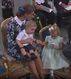 Princess Madeleine holding Prince Nicolas and tending to Princess Lenore at the Christening of Prince Alexander