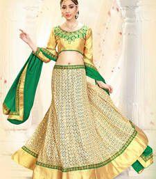 Get stylish beige lehengas online at Mirraw