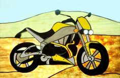 This picture shows a stained glass window depicting a Buell motorcycle with a sandy and green background, this window was based on a photo, the next image on this page.