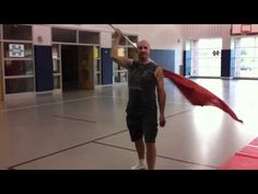 Flag trick - neck roll behind-the-head catch