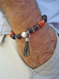 Beads w/ metal. Attention to leather strip.
