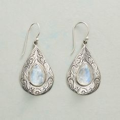 "MYSTICAL RAINDROP EARRINGS -- Sparkling teardrop cabochons of rainbow moonstone are framed on delicately engraved sterling silver drops. Sterling French earwires. Imported. 1-7/8""L."