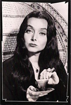 Morticia Having Tea.