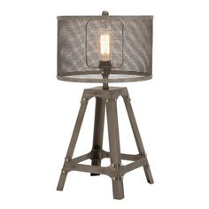 This Superb Unique Styled Metal Table Lamp with Drum Shade is made of quality materials and will be a great addition to your space.