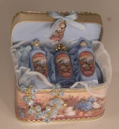 Case FilledW/Perfume Bottles #1 by Syreeta's - $63.00 : Swan House Miniatures, Artisan Miniatures for Dollhouses and Roomboxes