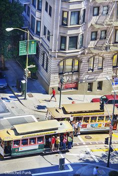 High Angle View Of Two Cable Cars Passing On Powell Street, San Francisco   www.mitchellfunk.com