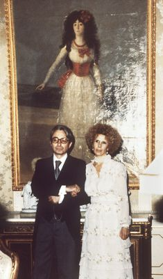 DUCHESS OF ALBA by GOYA~    The famous portrait painted by Goya of Cayetana de Silva, XIII Duchess of Alba. It hangs in the Goya salon in the Liria palace in Madris, of her successor Cayetana Fitz-James Stuart, XVIII the late Duchess of Alba, shown here with her second husband, Jesús Aguirre.