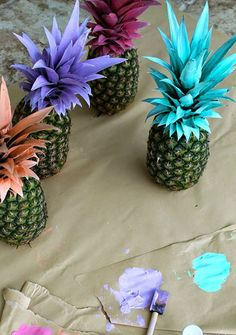 Or give your pineapples a little more pizazz by painting their leaves funky colors and adding a table number tag. You can learn just how Persuit of Shoes made these by clicking here.