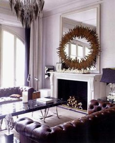 Lazaro Rosa-Violan, Contemporain Studio  The bronze from from 1900 was once a ceiling decoration while the chandelier was designed by Paco Rabanne.
