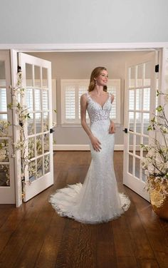Classic bridal glamour. Leaf-inspired lace V-neckline, shimmering embroidered details. The sheer details in the bodice add a hint of sexiness while showing off the intricate detail of the lace. The back uses illusion tulle to make the fabric-covered buttons and lace appliques float along the body effortlessly. The fit-and-flare silhouette makes this dress simple and chic without sacrificing a flowing skirt and delicate train.  Essense of Australia   Style: D3301 Crepe Wedding Dress, Fit And Flare Wedding Dress, Wedding Dress Styles, Dream Wedding Dresses, Bridal Dresses, Wedding Gowns, Lace Wedding, Wedding Happy, Vows Bridal