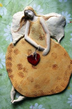This, only with a shell as the skirt base. And beach theme Ceramics Projects, Clay Projects, Clay Crafts, Angel Sculpture, Sculpture Clay, Ceramic Wall Art, Ceramic Clay, Ceramic Bowls, Ceramic Figures