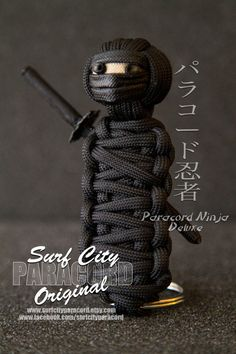 Surf City Paracord's original Paracord Ninja.   Made from 550 paracord, this legendary master of stealth will silently watch over your keys. Sword is made of paracord and securely attached to the Ninja's back. Deluxe features a larger head and king cobra weave for the body giving up to 5ft of cord.