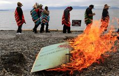 Hundreds of tribal members gathered to announce their opposition to development of a coal-shipping facility on their sacred land in Washington state. They ceremonially burned a check on the beach to make a statement that no amount of money could buy their support for a project that would destroy their village and burial sites on the property.