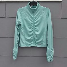 Adidas Ruched Running Jacket Light green running jacket.  Mock turtleneck, zip front.  Ruched along zipper and down arms.  Note:  loose thread on left cuff (see pic 4) not noticeable when worn as the sleeve is scrunched when wearing.  Paint on zip tab is chipped.  Some minimal pilling.  Good used condition.  Priced accordingly. Adidas Jackets & Coats