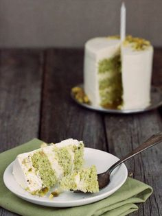a tender pistachio sponge cake made with ground pistachios is filled with a rich homemade lemon curd and white chocolate mousse and covered in a vanilla swiss meringue buttercream
