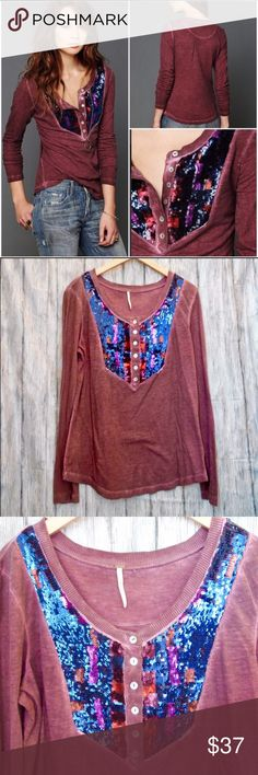 """Free People Sequin Bib Henley L Free People Sequin Bib Henley. It's a cross between maroon and purple on color. Lovely, soft cotton and perfect for fall with all the jewel tones in the sequins. In perfect condition. No flaws. Size L. Measurements: 20"""" pit to pit. 25"""" length. Free People Tops"""
