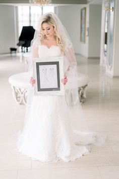 Our brides who design a custom wedding dress with Heidi Elnora Atelier get a sketch of their designer wedding dress. Here, Jordan shows off her lace wedding dress with sleeves and accompanying sketch. #wedding #weddingdress #customweddingdress #laceweddingdress #longsleeveweddingdress #designerweddingdress #bridalgown #bride