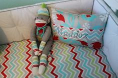 Great pairing of #red and #aqua in crib bedding and wall color.  #chevron #nursery #sockmonkey