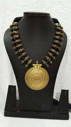 Golden Round Antique Pendant with Dark Green Crystal Oxidised Necklace is part of Gold pendant jewelry - Golden Round Antique Pendant with Dark Green Crystal Oxidised Jewellery Set With Dark Green Rope Contains 1 Necklace Gold Jewellery Design, Bead Jewellery, Metal Jewelry, Pendant Jewelry, Jewelry Sets, Gold Jewelry, Gold Bangles, Designer Jewellery, Handmade Jewellery