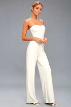 No matter the occasion, the Edith White Strapless Jumpsuit is sure to impress! Stretch knit shapes a strapless, bodice and wide, relaxed pant legs. Bridal Jumpsuit, Strapless Jumpsuit, Provonias Wedding Dress, Classic Wedding Dress, White Jumpsuit, Fashion Group, Blonde Balayage, Overall, Feminine Style