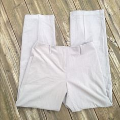 Khaki trouser pants In good used condition with no rips or stains. Pleated, flat waist, and no pockets. Closes with a lobster clasp and button. Thanks for looking. J.G. Hook Pants Trousers