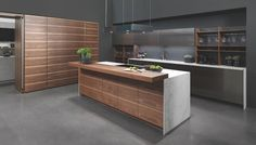 Polished steel | bookmatched walnut | dekton @openhauskitchens - New kitchen ideas from #rationalkitchens - extraordinary diversity and possibilitys verging on the bespoke #openhauskitchens #sussexkitchenshowroom #openhausdesignstudio #luxurysussexkitchens