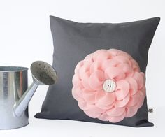 Pastel Pink Felt Flower PILLOW in Charcoal Gray Linen with White Button by JillianReneDecor Nursery Decor Floral Baby Shower Gift for Her. $49.50, via Etsy.