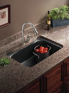 Using dark colors in the kitchen will perfectly showcase your sink.