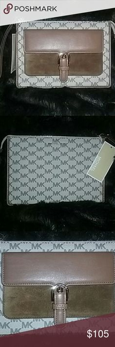 """Michael Kors Cooper Wristlet Michael Kors Cooper medium Wristlet measures 9 x 6.5 with a 7"""" wristlet strap. Gold tone hardware and one front snap pocket. MK signature coated canvas. Interior has 1 slip pocket and 6 credit card slots. Michael Kors  Bags Clutches & Wristlets"""