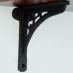 """Clover Cast Iron Shelf Bracket - 6-1/2"""" x 5-3/4"""" - Black Powder Coat by Whittington Collection. $12.95. Add a charming touch to your home with this iron shelf bracket that features a small three-leaf clover motif and other decorative cutouts. Shown in Rust finish. Bracket dimensions: 6-1/2 L x 5-3/4 H. Shelf support section of the bracket is 1-1/2 wide. Wall support section of the bracket is 7/8 wide; 2-3/8 wide where the mounting screws are placed. Made of durable cast iron. Ru..."""