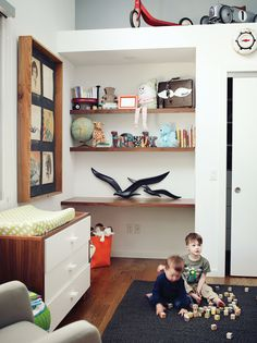 Built-in shelves and a changing table by Ducduc in Hawk's room offer ample storage.  Photo by: Joe Pugliese      Read more: http://www.dwell.com/slideshows/a-little-bit-country.html?slide=13=y=true#ixzz28k5TwnUP