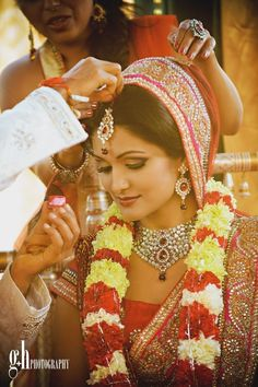 Indian wedding photography. Indian bride wearing bridal lehenga and jewelry. #IndianBridalHairstyle #IndianBridalMakeup