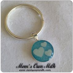 This design is becoming quite popular it seems. Triple heart with a diamond dust overlay.   Available in charms, pendants and key rings.   Order: mom@momsownmilk Facebook, Twitter, Pinterest & Instagram: @momsownmilk www.momsownmilk.com/products   #momsownmilk