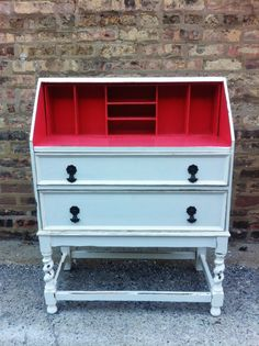 vintage white secretary desk with pink painted inside