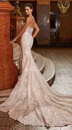 Strapless lace mermaid wedding dress with plunging neckline | Romantic bridal gown with long train | Val Stefani Wedding Dresses Fall 2021 - Opus Collection - Diva – Style D8273 | See more gorgeous bridal gowns by clicking on the photo - Belle The Magazine
