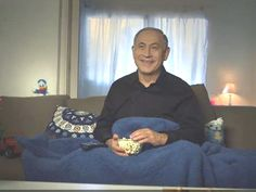 Few sights are as unnerving as seeing a giggling Benjamin Netanyahu throwing popcorn into his mouth under a duvet as he watches a video of himself shouting at children.