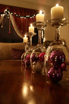 Simple DIY holiday decor using wine glasses! :: Turn wine glass upside down & use it as a glass lid for a small arrangement of Christmas decorations (ornaments, ribbon, whatever you like). Then place mini candles on top! Noel Christmas, All Things Christmas, Winter Christmas, Christmas Crafts, Christmas Ornaments, Christmas Candles, Christmas Centerpieces, Christmas Balls, Table Centerpieces