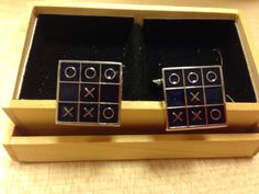 A pair of black enamel stainless steel cufflinks.  Priced at $58.  CNY special Purchase now till jan 31 at $38.